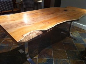 Yew slab dining table on chrome legs