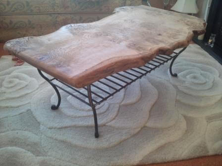 Solid oak coffee table with wrought iron magazine rack/shelf
